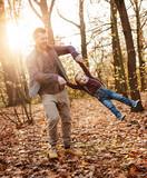 Joyful family enjoying great, autumnal weather - 235786292