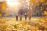 Joyful family enjoying great, autumnal weather - 235787642