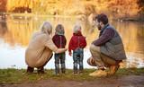 Joyful family enjoying great, autumnal weather - 235787812