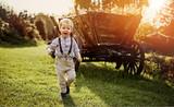 Cheerful boy on a farm - 235788425