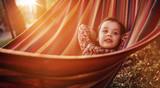 Cute little girl relaxing on a hammock - 235788644