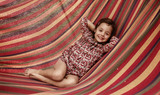 Cute little girl realxing on a hammock - 235788677
