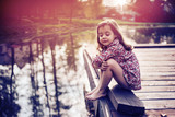 Cute little girl relaxing by the lake - 235788883