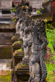 Balinese Stone Statuary at the Hindu Temple. Ancient stone carvings depicting the battle between good and evil meant to protect the temple and the worshipers.