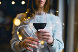 woman with glass of wine - 235809254