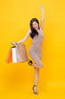 Happy excited Asian woman with shopping bags for sale concept
