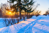 Colorful sunset in countryside at winter - 235822868