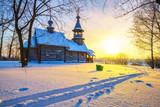 Small russian church in winter park at sunset - 235823239