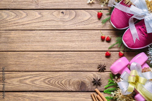 Leinwanddruck Bild Fitness and Healthy Christmas sport composition. Flat lay of sport shoes, dumbbells and decoration bows. Merry Christmas and Happy new year concept special for fitness healthy lifestyle.