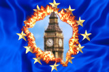 European flag on fire for United Kingdom exit with blurred Big Ben tower of London, the house of a British parliament. The financial concept for Brexit and EU division.