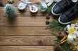 Leinwanddruck Bild - Flat lay black sneaker, mini christmas tree, gold and silver bows, Christmas ornaments on wood background, Merry Christmas fashion background concept. Top view with copy space.
