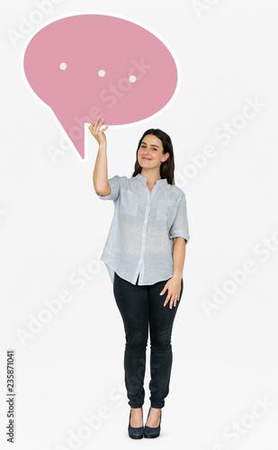 Leinwanddruck Bild Cheerful woman holding a speech bubble symbol