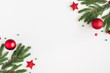 Leinwandbild Motiv Christmas composition. Fir tree branches, red decorations on pastel gray background. Christmas, winter, new year concept. Flat lay, top view, copy space