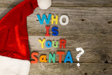 Guess who is your Santa Claus concept with colorful plastic letters on wooden background - 235882288