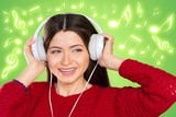 Happy young woman listening music with headphones