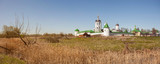 Panoramic view of Peshnoshsky monastery with white walls and the clear blue sky