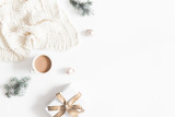 Christmas composition. Gift, fir tree branches, plaid, cup of coffee, balls on white background. Christmas, winter, new year concept. Flat lay, top view, copy space