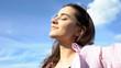 Leinwandbild Motiv Pretty female enjoying sunshine, relaxing with eyes closed outdoors, holiday