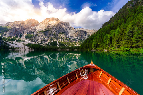 Leinwandbild Motiv Lake Braies (also known as Pragser Wildsee or Lago di Braies) in Dolomites Mountains, Sudtirol, Italy. Romantic place with typical wooden boats on the alpine lake.  Hiking travel and adventure.