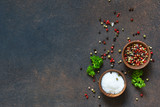 A variety of spices on a concrete background. Salt. Pepper. Top view - 235938467