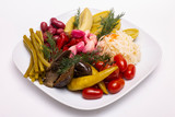 Pickles in assortment on a plate. Restaurant dish.  - 235939214