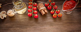 everything on wood table for the preparation of acute Italian sauce
