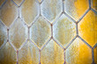 Detail of an old window with handmade leaded glass