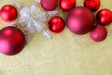Christmas Bulbs and Star Tree Topper Framing Gold Glitter Background