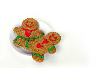 Christmas Gingerbread Man and Woman on Plate Isolated with Text Merry Christmas