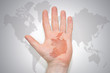 hand with map of ireland on the gray world map background. - 235983494