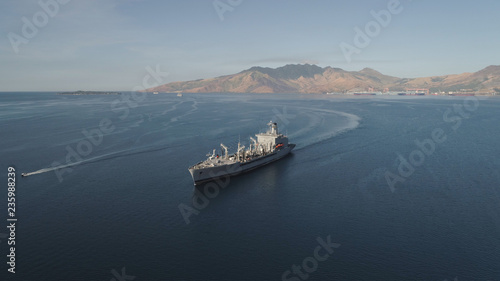 Aerial view: Cargo, Reefer ship in the sea bay. Subic Bay, Philippines, Luzon. Cargo ship in the harbor, against the backdrop of the mountains.