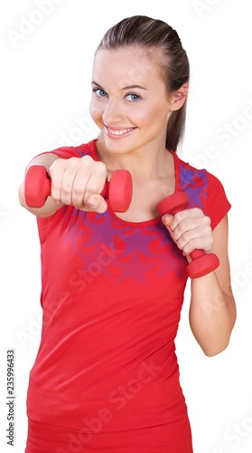 Young woman punching with hand weights