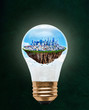 Floating City of San Francisco Inside Light Bulb With Copy Space. Concept of eco-friendly, energy efficient city and idea of environmental conservation in modern green city.