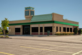 Unoccupied generic front side of store, business or professional office space. Sunny summer day. - 236026883