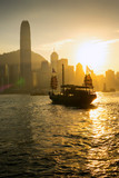 The Boat on Victoria harbour with sunset at Hong Kong. © Kanokpol