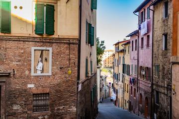 narrow cobblestone street in Siena