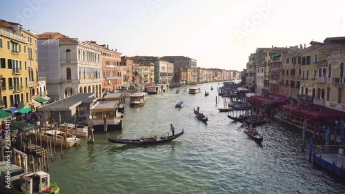 A lot of traffic on the main canal in Venice, the Canale Grande, seen from the famous Rialto Bridge.