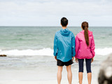 Young couple standing at beach