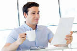 Young businessman in office with a mug - 236055081