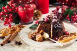 Christmas fruit pudding on a plate - 236058862