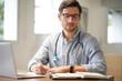 Leinwandbild Motiv  Handsome doctor in office