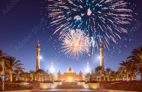 Leinwanddruck Bild Beautiful fireworks above Sheikh Zayed Grand Mosque at sunset Abu-Dhabi, UAE