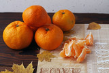 Tangerines are delicious and fragrant peeled and peeled on the table.