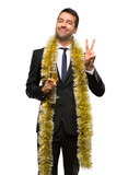 Man with champagne celebrating new year 2019 happy and counting two with fingers on isolated white background - 236083803
