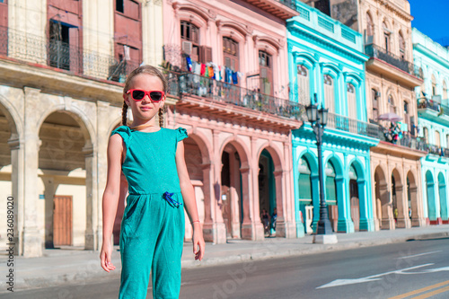 fototapeta na ścianę Tourist girls in popular area in Havana, Cuba. Young woman traveler smiling