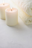 White candles, white towels
