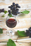 Red wine concept with bottle, glass and grapes - 236115448