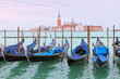 View of gondolas on Grand Canal and San Giorgio Maggiore church. Venice cityscape. Italy.