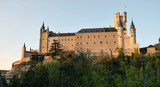 Medieval Segovia castle in Spain at sunset - 236124400