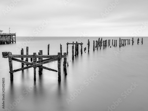 Old derelict pier, Swanage, Dorset, Jurassic Coast, World Heritage Site,; long exposure black and white image
